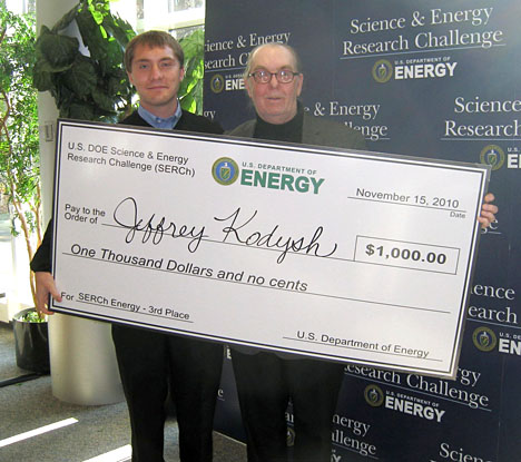 Jeff Kodysh, left, posed for a photo with the $1,000 prize he received for placing third in the energy division of the U.S. Department of Energy's 2010 Science and Energy Challenge. His adviser, Dr. David Nemeth, professor of geography and planning, also attended the competition in Chicago.
