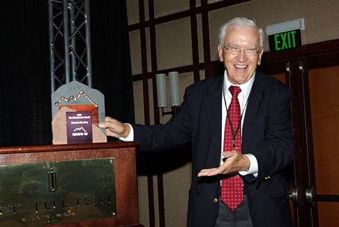 Dr. Maurice Manning showed off the 2010 Meienhofer Award for Lifetime Achievement in Peptide Chemistry at the recent Roche Colorado Corporation Peptide Symposium.