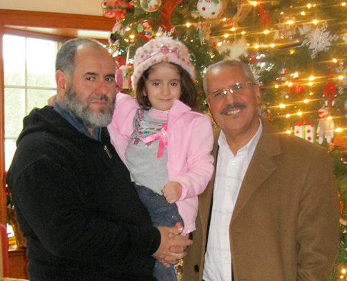 Dr. Azedine Medhkour, right, posed for a photo with his patient, Ryma Djoudad, 5, and her father, Abdenour Djoudad, at The LightHouse in Perrysburg. Medhkour and area physicians corrected Ryma's spinal cord defect last fall.