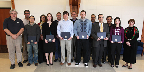 The newest recipients of University Fellowships were recognized by Dr. Mark Templin, chair of the Graduate Council Executive Committee, far left, and Dr. Patricia Komuniecki, vice provost for graduate affairs and dean of the College of Graduate Studies, far right, along with the students' advisers.