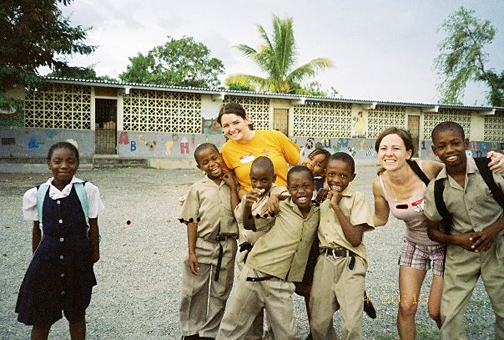 Jessica Kelley, left, and Jaime Schuette took a break from mission work in Jamaica to play with local children.