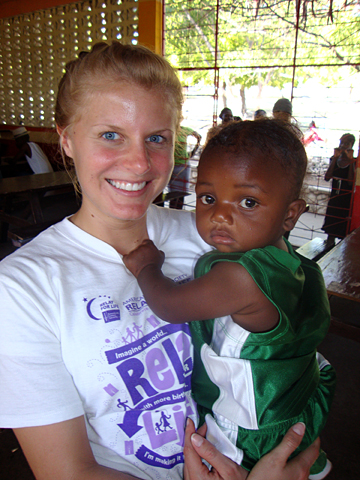 Rachel Powell held a baby in Montrouis, Haiti, during her recent with Mission Possible.