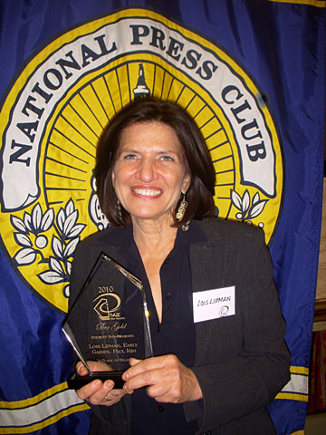 "Lois Lipman posed for a photo with the Television Internet and Video Association Peer Gold Award she received for her documentary, ""A Place to Belong."""