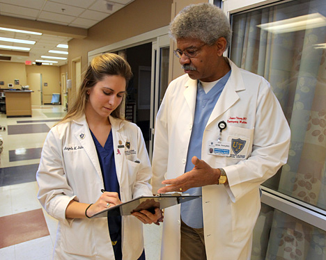 Dr. James Young, assistant professor of emergency medicine, went over a patient's chart with Angela Johnson, a second-year medical student, who is in the Scribe Program.
