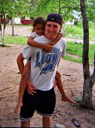 Stephen Urbanski posed for a photo with one of the children he met while on a mission trip to Honduras.