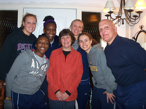 Cindy and Dr. Clint Longenecker posed for a photo with Toledo basketball players, from left, Melissa Goodall, Lecretia Smith, Andola Dortch, Haylie Linn and Naama Shafir.