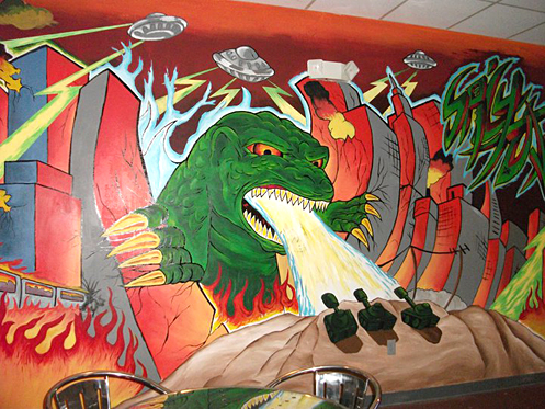 Benardo Diaz painted the Godzilla invading downtown Toledo on the back wall of the Spicy Tuna Sushi Bar and Grill.