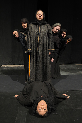 """Starr Chellsea Cutino plays Adela, who is dying in this scene from """"The House of Bernarda Alba"""" as her mother, grandmother and sisters watch. From left, the cast includes Ashley Stephens as Angustias, Jillian Albert as Martirio, JoEllen Jacobs as Bernarda Alba, Lynnette Bates as Maria Josefa, Megan Aherne as Amelia and Aleta Scott as Magdalena."""