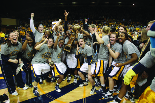 The Rockets celebrated and posed for photos with the WNIT Championship trophy after beating Southern Cal, 76-68, Saturday in front of 7,301 fans in Savage Arena.