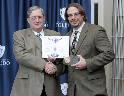 President Lloyd Jacobs, left, recognized Dr. Tavis Glassman as the Jefferson Award Champion last month.