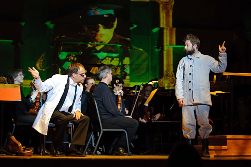 Dr. Ben Pryor, dean of the College of Innovative Learning and assistant vice provost, and UT alumnus Pete Cross rehearsed with the Toledo Symphony Orchestra at the Peristyle while projections designed by UT film major Brandon Boettler played behind them.