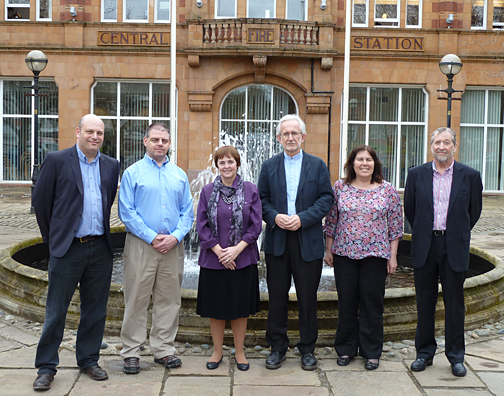 Dr. Brian Ashburner and Dr. Patricia Komuniecki, second and third from left, posed for a photo with University of Salford colleagues, from left, Darren Brooks, Martin Hall, Judith Smith and David Storey.