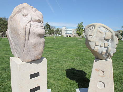 """Happy Happy,"" left, and ""The Invention,"" glacial granite, by Giancarlo Calicchia"