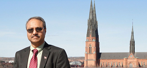 Dr. Abdul-Majeed Azad posed for a photo in front of Uppsala Cathedral in Sweden.
