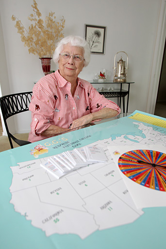 Dorothy Schabeck showed off G.G.'s Red/Blue Electoral College Game she created.