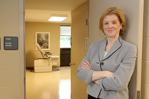 Sherry Moyer stood outside the new exam room for the Adolescent Girl's and Women's Wellness Initiative, which is part of the Center for Excellence in Autism.