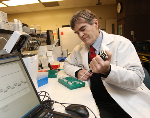 Dr. James Willey worked on his cancer research with biomarkers.