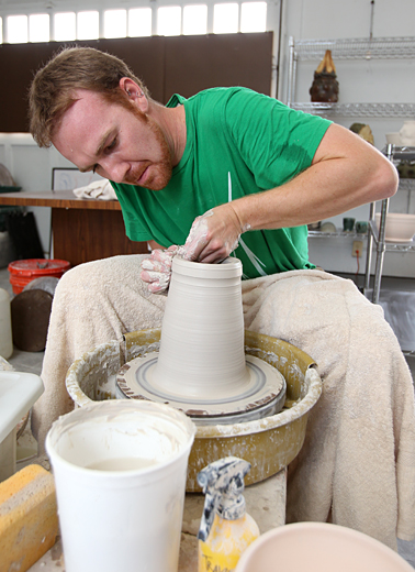 Travis Sanderson worked on a vase for Art on the Mall.