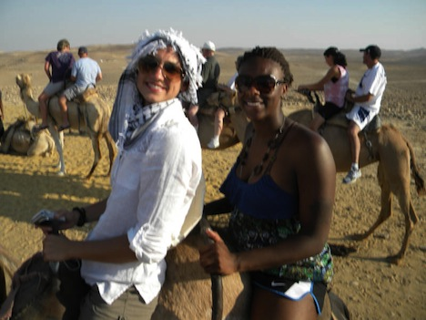 Women's basketball players Riley McCormick and Yolanda Richardson rode a camel in a Bedouin Village.