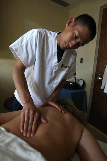 Licensed Massage Therapist Hieu Nguyen gave a massage to UT Police Lt. Julie Rightnowar.
