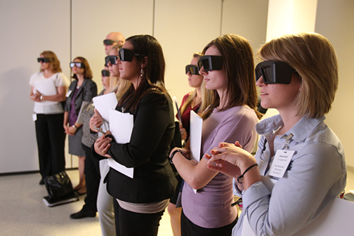 Legislative staffers from Ohio's General Assembly and U.S. Sen. Sherrod Brown's office looked at a 3D virtual reality projection of a human lung in the Interprofessional Immersive Simulation Center in the Collier Building.