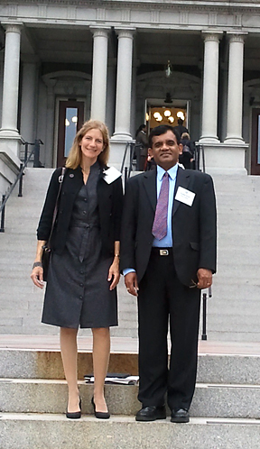 Dr. Jeanine Diller and Dr. Sudershan Pasupuleti posed for a photo in front of the Eisenhower Executive Building of the White House. They went to Washington, D.C., to learn more about President Obama's of the Interfaith and Community Service Campus Challenge.