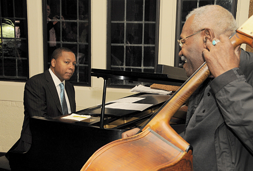 Wynton Marsalis studied the hands of Toledo bass player Clifford Murphy as they surprised a lucky few with a jam session in Libbey Hall following the lecture. Murphy told the trumpeter he played piano just like his father, Ellis Marsalis.