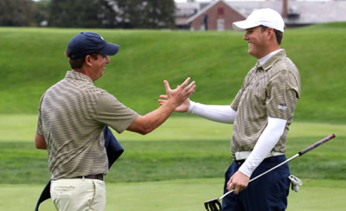 Toledo Head Men's Golf Coach Jamie Mauntler, left, congratulated Dugan Murphy for winning the Inverness Collegiate.