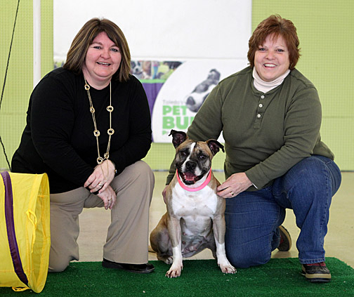 Cindy Reinsel, left, and Carol Humberger posed for a photo with Gretel at the PET Bull Project Education Center.