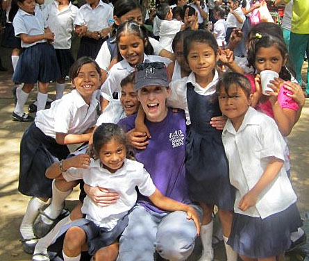 Jeanetta Mohlke-Hill posed for a photo with students at the Reina Sofia Elementary School during the Honors College's trip to Nicaragua last year.