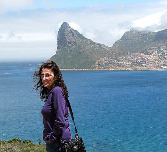 Dr. Barbara Alice Mann posed for a photo in South Africa with the city of Cape Town in the distance.