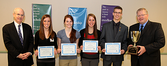 Dr. Jeffrey Gold, chancellor and executive vice president for biosciences and health affairs, and dean of the College of Medicine and Life Sciences, left, and Dr. Timothy Gaspar, dean of the College of Nursing, posed for a photo with members of the 2012 Brain Bowl winning team, from left, Haley Johnson, Heather Gallagher, Betsy Hayes and Joshua Conklin.