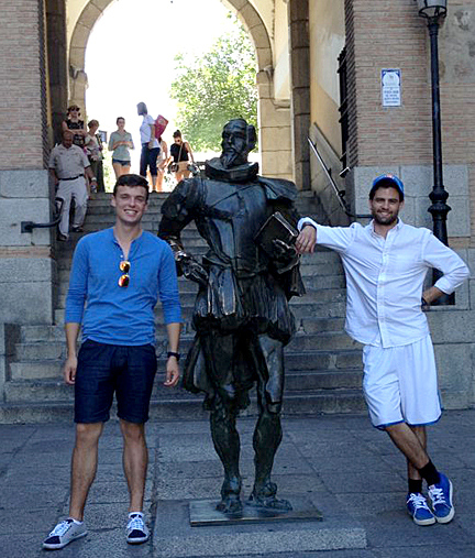 UT students Daniel Hoffman, left, and Neil Smith posed for a photo by a statue of Miguel de Cervantes in Toledo, Spain, last summer.