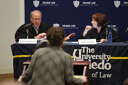 Ohio Sixth District Court of Appeals Judges Peter M. Handwork and Arlene Singer, a 1976 alumna of the UT College of Law, directed questions to an attorney during oral argument held at the College of Law in spring 2012.