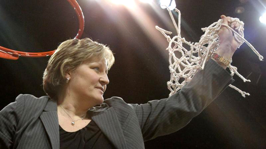 Head Coach Tricia Cullop held up the net after the Rockets defeated Eastern Michigan, 48-38, to win the Mid-American Conference regular-season crown in Savage Arena.