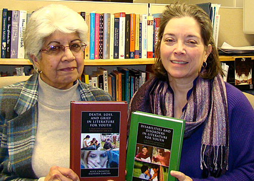 Rajinder Garcha, left, and Alice Crosetto posed for a photo with their books.