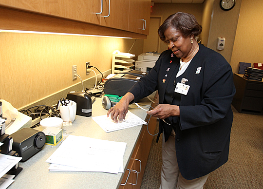 Volunteer Ethel Penamon assists with administrative tasks in the George Isaac Minimum Invasive Surgical Center.