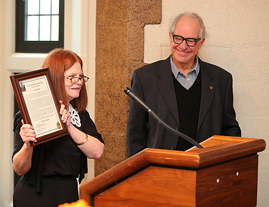 Dr. Sara Lundquist, associate professor and chair of English, presented Joel Lipman with a certificate in honor of his professor emeritus of English designation.