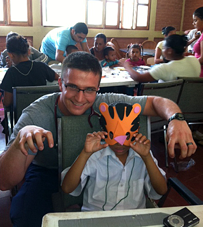 Nursing student Lee Rosenberg helped a student with an art project during a visit to an orphanage in Nicaragua.