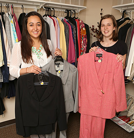 Claudia Cortez, a senior in the College of Business and Innovation who is an intern in the Catharine S. Eberly Center for Women, left, Emily Hardcastle and showed off some of the professional attire donated to Kate's Closet.