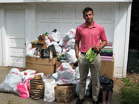 Jordan Keefe showed off some of the more than 1,200 pairs of shoes he has collected so far through Save The Feet. He plans to take the footwear to distribute in Les Cayes, Haiti.