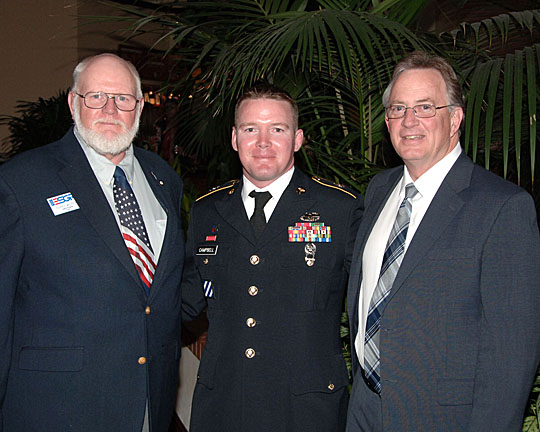 Army Staff Sgt. Jeremy Campbell, UT surgical technician, center, posed for a photo with Terry Witter, regional director of the Employer Support of the Guard and Reserve, left, and Edwin Hall, UT administrator of surgical services, at the Department of Defense Employer Recognition Banquet in Columbus.