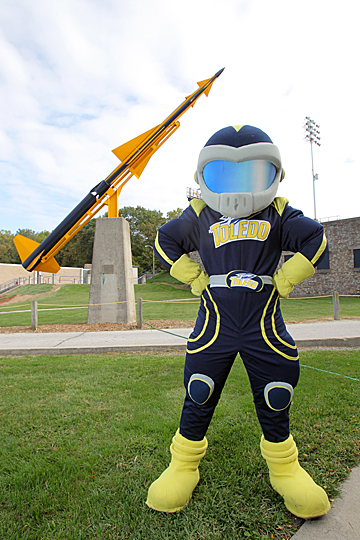 Rocky is ready to have a blast in the Capital One Mascot Challenge, but he needs your help: Be sure to vote!