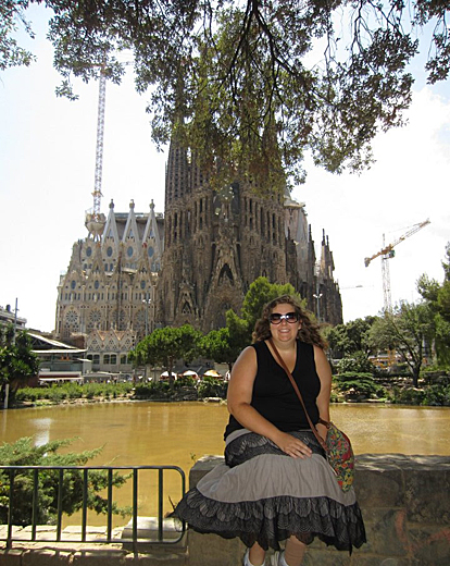 Lydia Kane, a film major who participated in an International Study Abroad Program in Barcelona, Spain, in 2012, stopped for a photo in front of the Sagrada Família church, one of the city's most popular attractions.