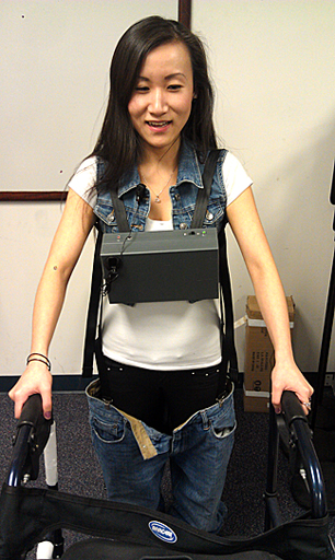 Xiaotong Li demonstrated the voice-activated device she and Aaron Kirgesner, Mitchell Cramer and Adam Stephens created to assist individuals who have mobility issues with lifting and lowering their pants.
