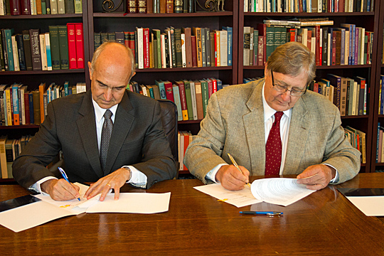: Dr. Peter Dorman, president of the American University of Beirut, left, and UT President Lloyd Jacobs signed a memorandum of understanding for a collaboration between the two schools so faculty and staff at UT Medical Center and the UT Center for Diabetes and Endocrine Research will help create the Middle East Diabetes Research Center.