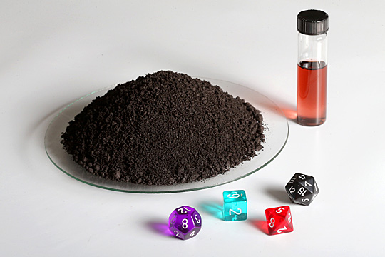 Dr. Terry Bigioni and his team were able to create about 140 grams, shown above, of the stable silver nanoparticle, which is many times greater than typical production amounts. The dice represent the various shapes the atoms comprising the nanoparticle take as they create an interlaced cage, ensuring the stability of the nanoparticles.