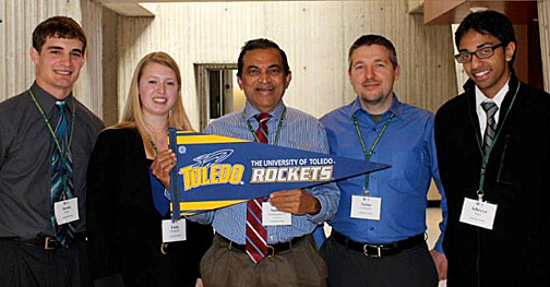 Supply chain management students who won first place at the 2013 Supply Chain Case Competition posed for a photo with their faculty adviser. They are, from left, Justin Blake, Emily Burghardt, Dr. P. S. Sundararaghavan, Sasha VonSacken and Athreya Rajan.