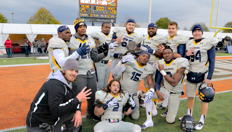 Rocket seniors showed off the Battle of I-75 Trophy and flashed four fingers as they've beat Bowling Green four straight years.