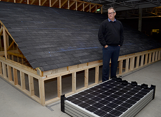 Dr. Brandon Cohen showed the model roof used to test the installation of residential photovoltaic systems in an effort to make solar power more affordable.